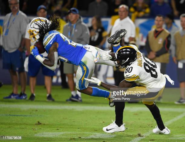 Rayshawn Jenkins of the Los Angeles Chargers intercepts a pass intended for Johnny Holton of the Pittsburgh Steelers during the fourth quarter at...