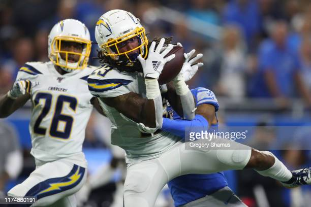 Rayshawn Jenkins of the Los Angeles Chargers makes a third quarter interception in front of Marvin Jones of the Detroit Lions at Ford Field on...