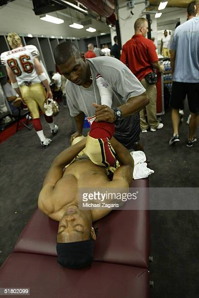 Rayshun Reed of the San Francisco 49ers stretches in the locker room before the game against the Tampa Bay Buccaneers at Raymond James Stadium on...