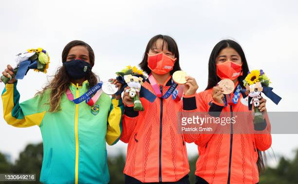 Rayssa Leal of Team Brazil and Momiji Nishiya and Funa Nakayama of Team Japan pose with their medals during the Women's Street Final medal ceremony...