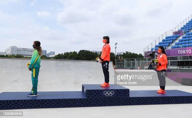 Rayssa Leal of Team Brazil, winner of the silver medal, and Momiji Nishiya, winner of the gold medal, and Funa Nakayama, winner of the bronze medal,...