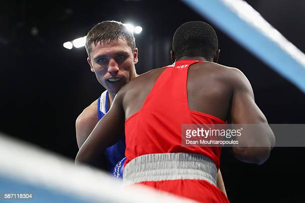 Rayton Nduku Okwiri of Kenya and Andrei Zamkovoi of Russia compete in the Men's Welter 69kg preliminary bout on Day 2 of the Rio 2016 Olympic Games...