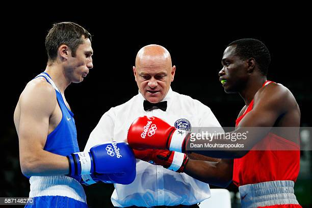 Rayton Nduku Okwiri of Kenya and Andrei Zamkovoi of Russia get ready to compete in the Men's Welter 69kg preliminary bout on Day 2 of the Rio 2016...