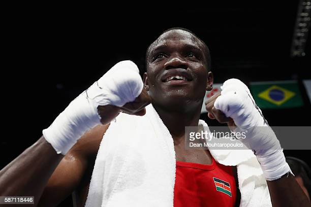 Rayton Nduku Okwiri of Kenya celebrates victory against Andrei Zamkovoi of Russia after they compete in the Men's Welter 69kg preliminary bout on Day...
