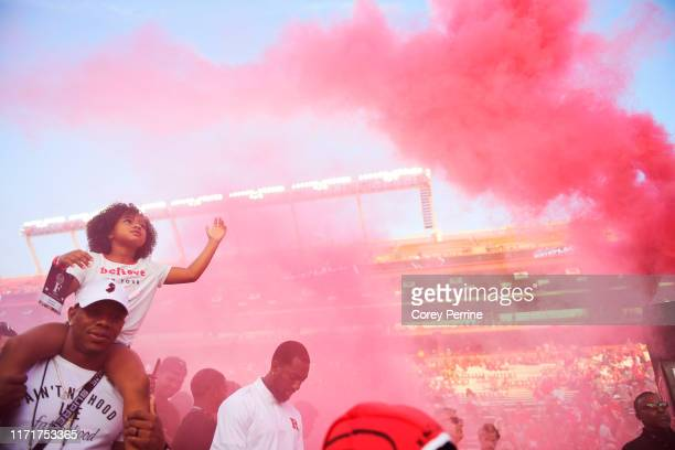 Rayven Rice, 7-years-old admires smoke while on the shoulders of her father Ray Rice, a former NFL running back with the Baltimore Ravens, before the...