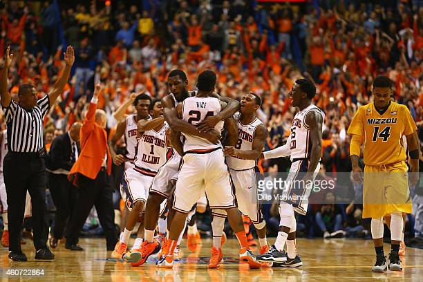 Rayvonte Rice of the Illinois Fighting Illini is mobbed by his teammates after making the game-winning shot as Keith Shamburger of the Missouri...