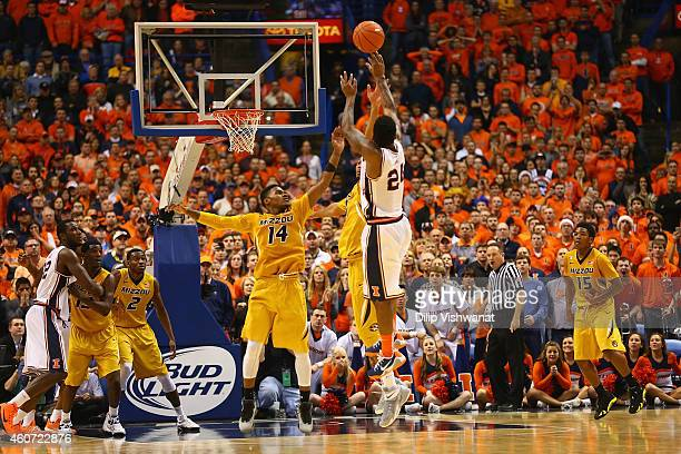 Rayvonte Rice of the Illinois Fighting Illini shoots the game-winning shot over Keith Shamburger of the Missouri Tigers during the 34th Annual Bud...