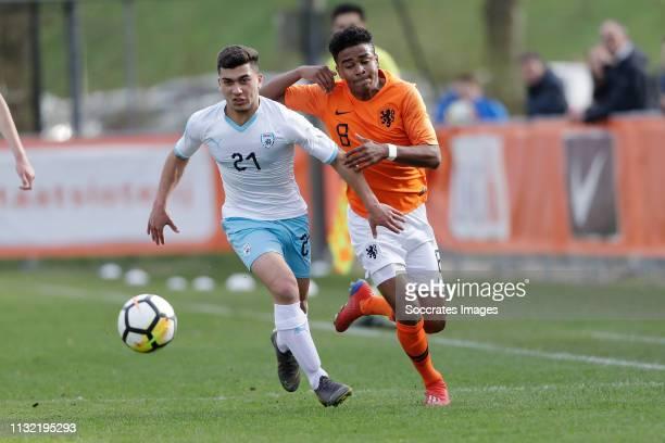Raz Bruchian of Israel Ian Maatsen of Holland U17 during the match between Holland U17 v Israel U17 at the Sportpark Zegersloot on March 23 2019 in...