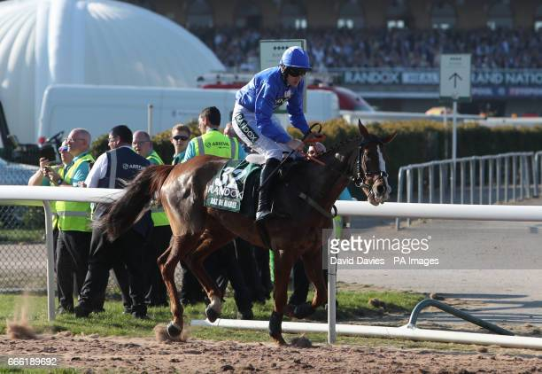 Raz De Maree ridden by G N Fox after a false start on the first attempt at starting the Randox Health Grand National on Grand National Day of the...