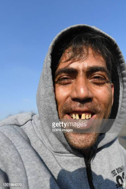 Raza from Afghanistan takes a selfie while smiling at Bira camp in Bihac. Bihac in north west Bosnia and Herzegovina is one of the epicenters of...