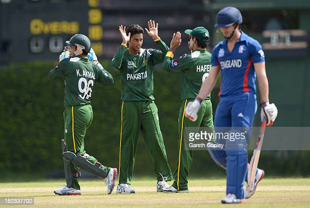 Raza Hasan of Pakistan celebrates with teammates after dismissing Craig Kieswetter of England during the ICC T20 World Cup Warm Up Match between...