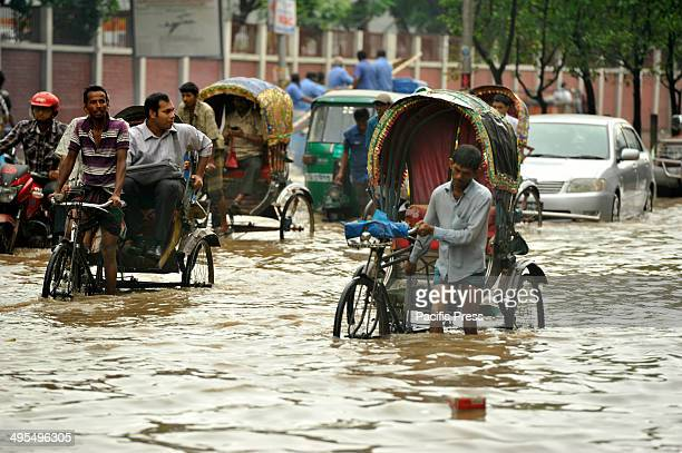 Razarbag Road in Dhaka is submerged by flood water following incessant monsoon rain which has inundated the capital's roads and crossroads throughout...