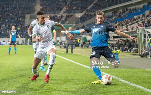 Razgrad's Anicet Abel and Hoffenheim's Alexander Rossipal in action during the Europa League group C soccer match between 1899 Hoffenheim and...