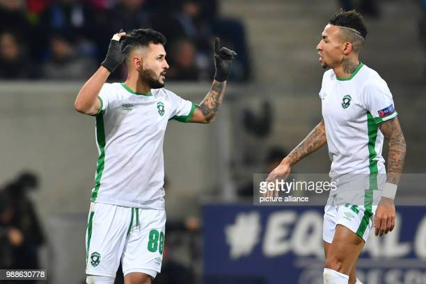 Razgrad's scorer Wanderson and Anicet Abel celebrate the 11 goal during the Europa League group C soccer match between 1899 Hoffenheim and Ludogorets...