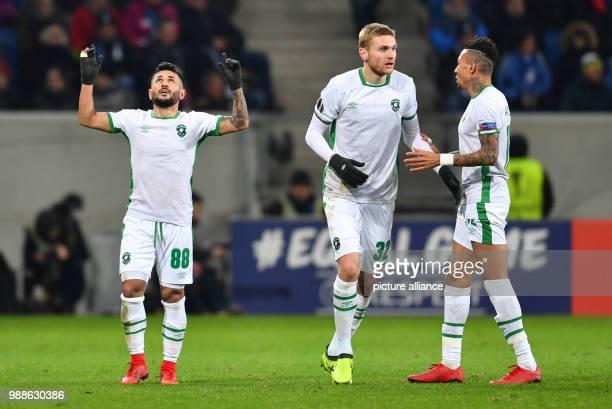 Razgrad's scorer Wanderson Igor Plastun and Anicet Abel celebrate the 11 goal during the Europa League group C soccer match between 1899 Hoffenheim...