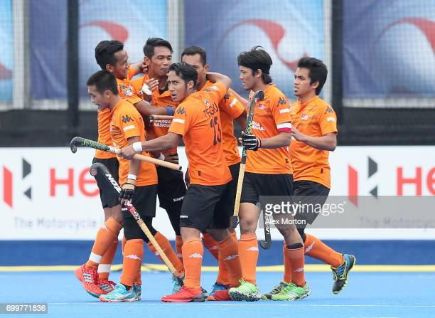 Razie Rahim of Malaysia celebrates scoring his teams third goal with teammates during the quarter final match between India and Malaysia on day seven...