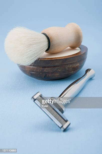 Razor and shaving cream and brush