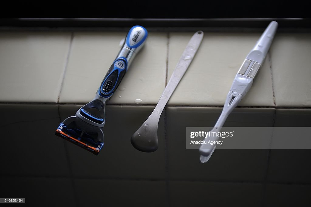 A razor and tooth brush are lie on the windowsill of the bathroom at the minimalist Katsuya Toyodas apartment in Tokyo, Japan, on July 02, 2016. Katsuya Toyoda, an online publication editor, decided to live less cluttered with useless personal and domestic possessions about one years ago so he could let things he truly liked surface in his life. This philosophy 'Minimalism' has become famous in recent years in Japan especially between young people who want nothing to do with acquiring material possessions, but would rather spend their money, time, and effort on things that they truly enjoy. Minimalism is a different style that uses pared-down design elements. Minimalism in the arts began in postWorld War II Western art, most strongly with American visual arts in the 1960s and early 1970s.