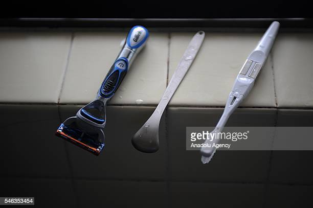 A razor and tooth brush are lie on the windowsill of the bathroom at the minimalist Katsuya Toyodas apartment in Tokyo Japan on July 02 2016 Katsuya...