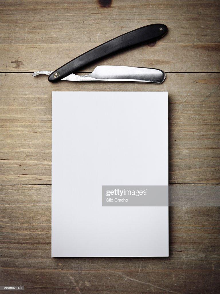Razor and white paper : Foto stock