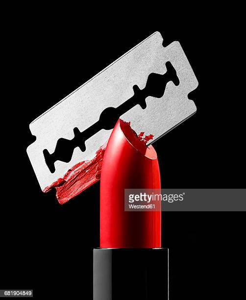 razor blade cutting through red lipstick - razor stock photos and pictures
