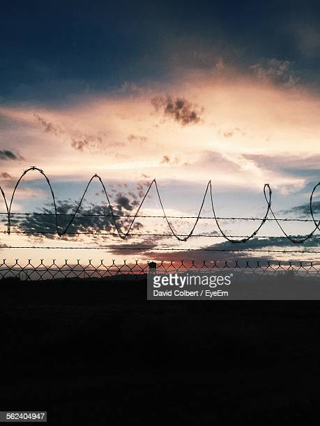 Razor Fence Against Cloudy Sky