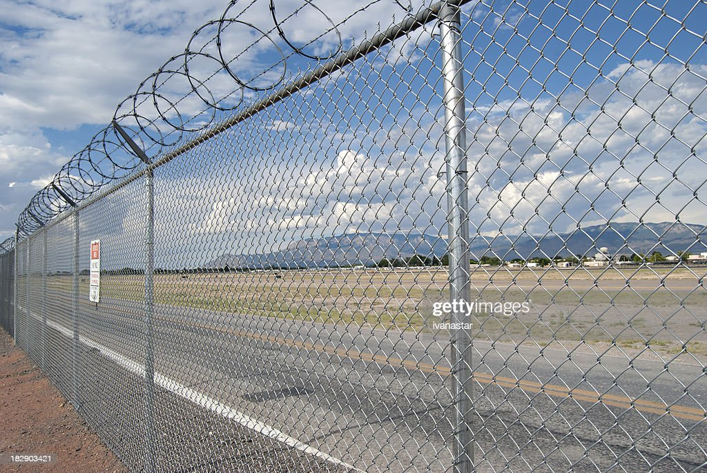 Razor Wire Above Airport Fence Stock Photo   Getty Images