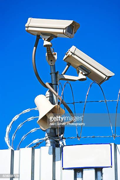 Razor Wire and Security Cameras atop a Fence