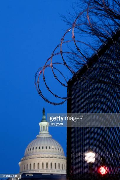 Razor wire fencing surrounds the US Capitol on January 15, 2021 in Washington, DC. After last week's Capitol Riot the FBI has warned of additional...
