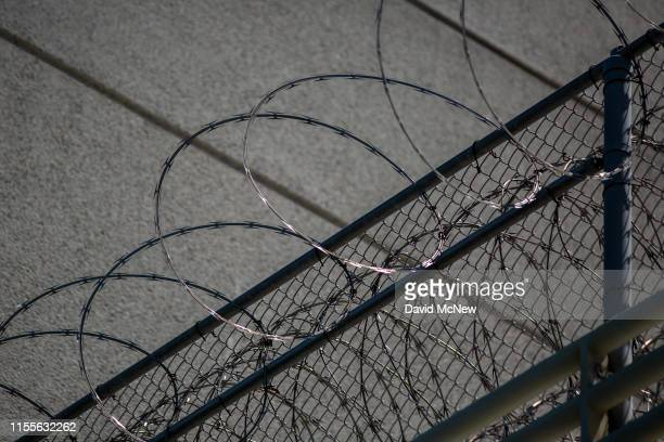 Razor wire is seen on the Metropolitan Detention Center prison as mass arrests by federal immigration authorities as ordered by the Trump...
