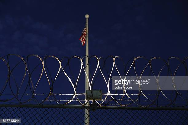 Razor wire lines the fence of the Gitmo detention center on October 22 2016 at the US Naval Station at Guantanamo Bay Cuba The US military's Joint...