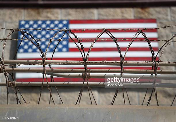 "Razor wire lines the fence of the ""Gitmo"" maximum security detention center on October 22, 2016 at the U.S. Naval Station at Guantanamo Bay, Cuba...."