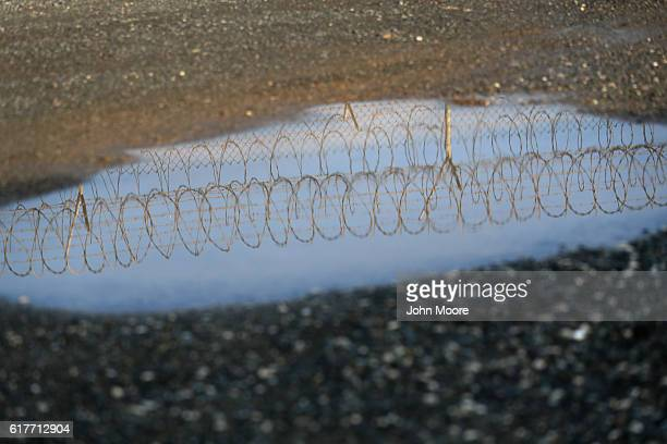 Razor wire reflects outside the US prison at Guantanamo Bay also known as Gitmo on October 22 2016 at the US Naval Station at Guantanamo Bay Cuba The...