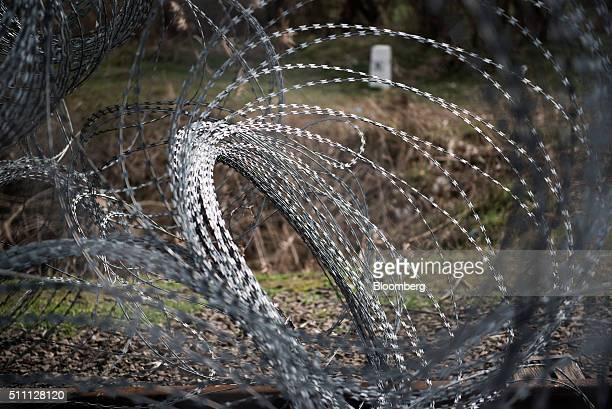 Razor wire sits coiled by security fence as it stands on the HungarianSerbian border near Roszke Hungary on Wednesday Feb 17 2016 The European Union...