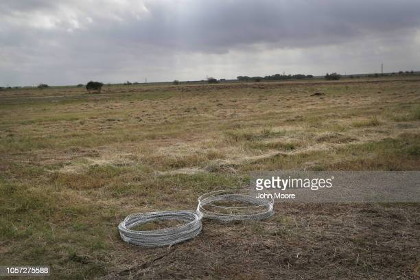 Razor wire sits in a field as US Army soldiers from Ft Riley Kansas prepare to string it up near the port of entry at the USMexico border on November...