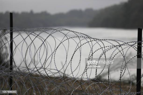Razor wire stretches out in the morning fog at the Rio Grande on the USMexico border on November 5 2018 in Donna Texas US Army troops had places the...