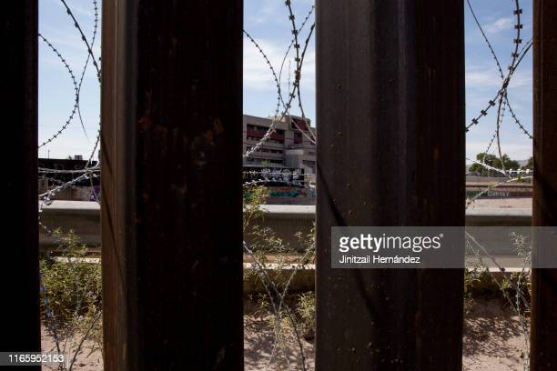 Razor wire supplemets the border fence in El Paso, Texas on Aug. 23, 2019.