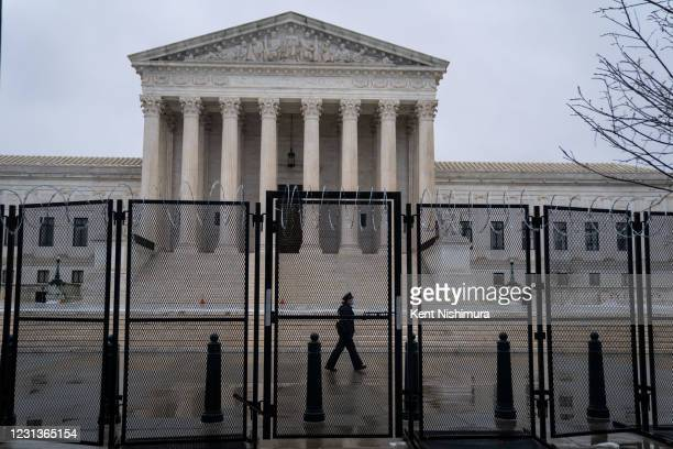 Razor wire topped fencing is seen surrounding the Supreme Court of the United States on Monday, Feb. 22, 2021 in Washington, DC.
