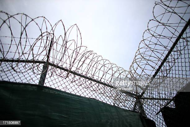 Razor wire tops a fence in camp 6 where prisoners are housed in a communal facility at the US military prison for 'enemy combatants' on June 25 2013...