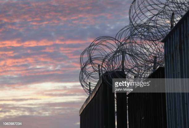 Razor wire tops the USMexico border fence on November 16 2018 in Tijuana Mexico US border agencies continued to fortify the fence with razor wire and...