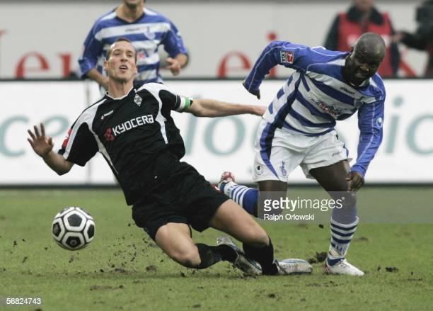 Razundara Tjikuzu of MSV Duisburg tackles Jeff Strasser of Borussia Moenchengladbach during their Bundesliga soccer match in the Duisburg Arena on...