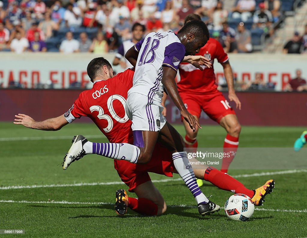 Razvan Cocis #30 of Chicago Fire slides in to block a shot by Kevin Molino #18 of Orlando City FC during an MLS match at Toyota Park on August 14, 2016 in Bridgeview, Illinois. The Fire and Orlando City SC tied 2-2.