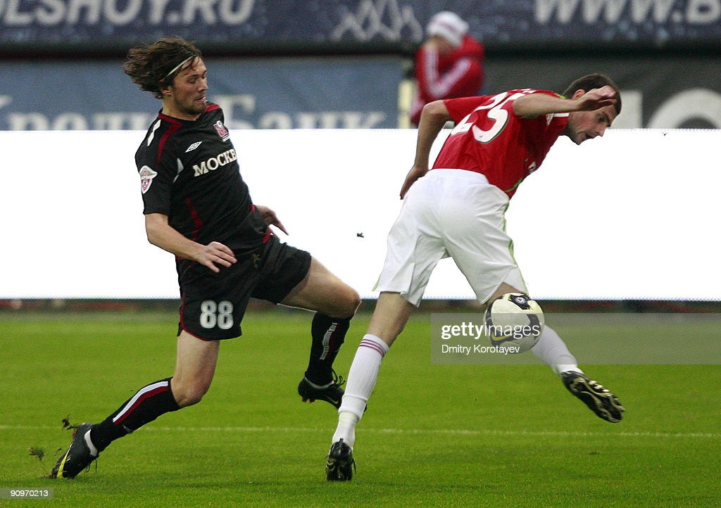 Razvan Cocis of Lokomotiv Moscow (R) is challenged by Edgaras Cesnauskis of FC Moscow during the Russian Football League Championship match between FC Lokomotiv Moscow and FC Moscow at the Lokomotiv Stadium on September 19, 2009 in Moscow, Russia.