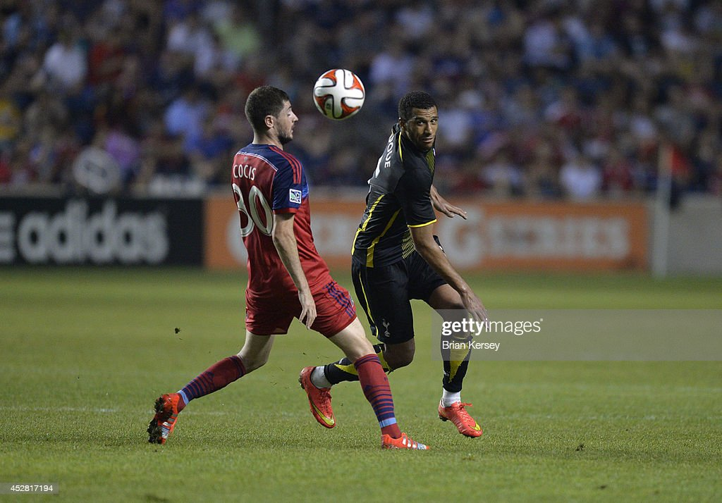 Razvan Cocis #30 of the Chicago Fire (L) and Etienne Capoue #15 of Tottenham Hotspur go for the ball during the second half at Toyota Park on July 26, 2014 in Bridgeview, Illinois. Tottenham Hotspur defeated the Fire 2-0.
