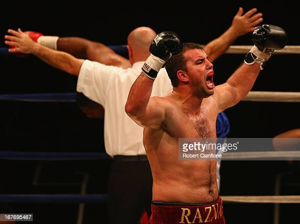 Razvan Cojanu of Romaia celebrates after defeating Paula Mataele of New Zealand in the undercard bout prior to the WBC Super Flyweight bout between...
