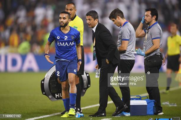 Razvan Lucescu Head Coach of Al Hilal SFC speaks to Mohammed Alburayk of Al Hilal SFC during the FIFA Club World Cup 2nd round match between Al Hilal...