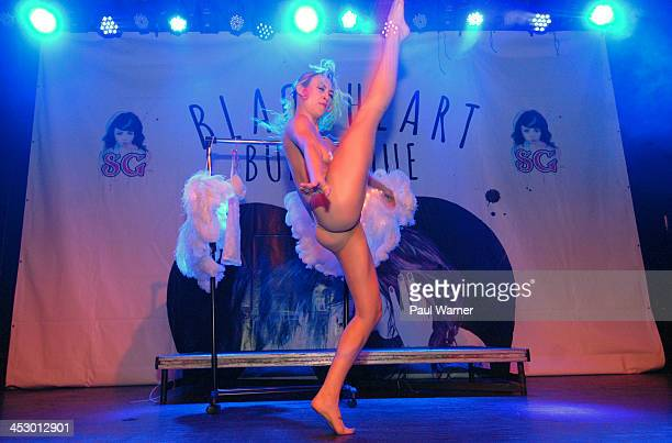 Razzi Suicide performs during the Suicide GirlsBlackheart Burlesque Tour at St Andrews Hall on December 1 2013 in Detroit Michigan