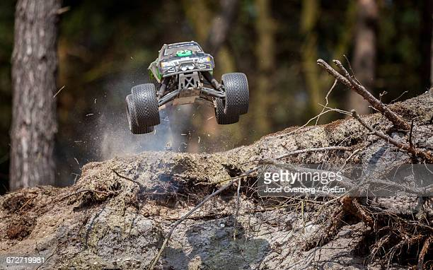 rc car in mid-air over field - rc car stock photos and pictures