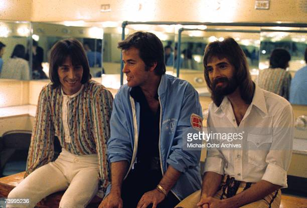 Rcok pop duo Loggins Messina consisting of Kenny Loggins and Jim Messina chat backstage with television host Dick Clark in circa 1974
