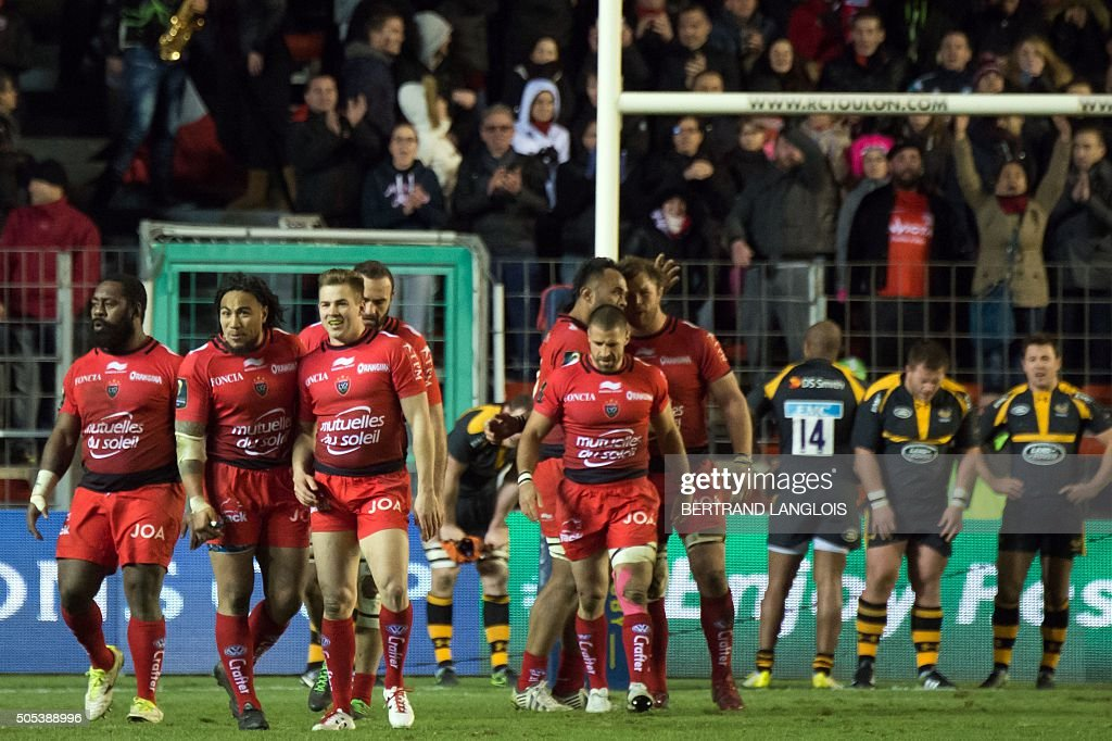 RCToulon's players celebrate after RC Toulon's Australian wing Drew Mitchell scoring a goal during the European Champions Cup rugby union match RC Toulon vs Wasps on January 17, 2016 at the Mayol stadium in Toulon, southeastern France.